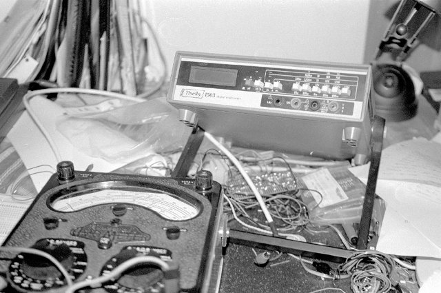 A Black and White photograph of the Thurlby 1503 digital multimeter. Shown in comparison to a Model 9 AvoMeter.